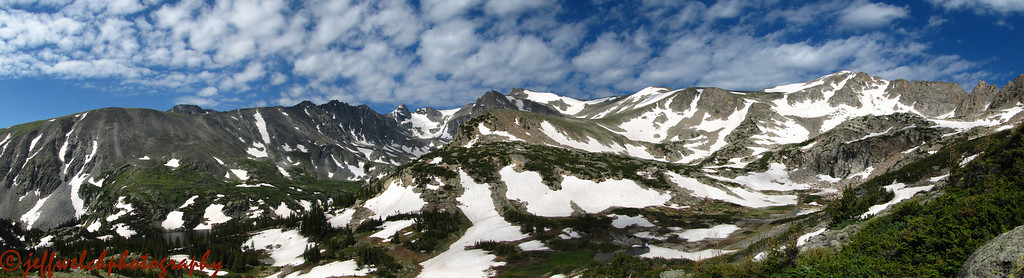A panoramic view of the Lake Isabelle cirque from partway up the ridge.