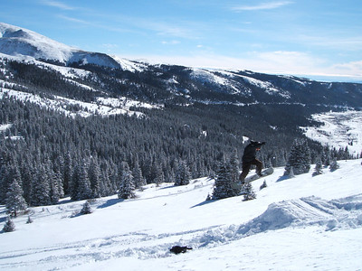 Ryan throwing a backside 180 on Hoosier Pass, CO.