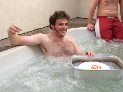 Then we had a hot tub session.  And hors d'oeuvre.  Charles came up with a brilliant solution to making the food easily accessible for all. Photo: Emilie