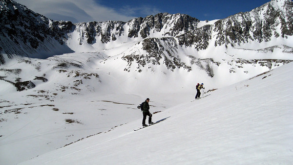 On Sunday, we skied a couple laps on a fun south facing run near the hut called Moby Dick.  Dan and Lindsey skinning up with an incredible backdrop.