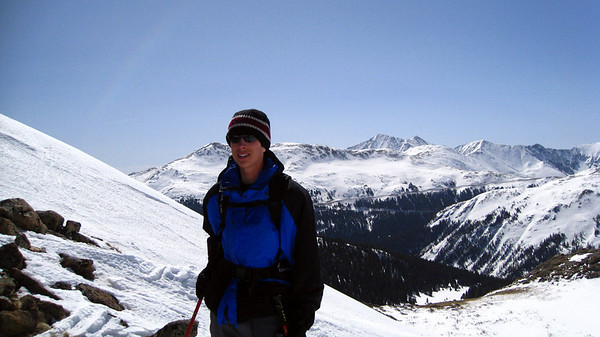 Adam with Loveland Pass, the 7 Sisters, Mt. Sniktau, and Torrey's Peak in the background.