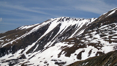 Mt. Buckskin, a high 13er, nearby.  The two long gullies on the east face look tantalizing.