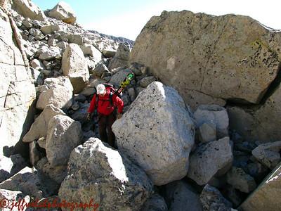 Lacy navigates a boulderfield.