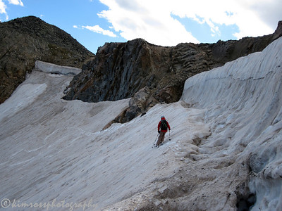 "Me traversing to the better ""snow"" below the big cornice feature just after the committing entrance. Photo: K.Ross"