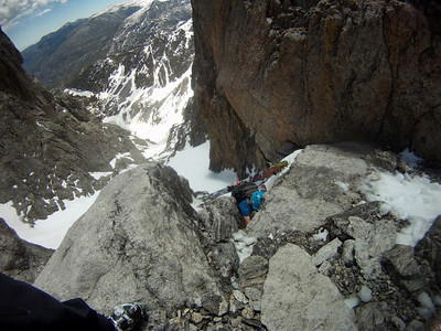 Me climbing through the crux.  It was more intimidating than difficult - 10ft of nearly vertical snow led to a simple 3rd class step.  However, the consequences of falling involving pinballing off rocks all the way to the bottom of the couloir.  Photo: M. Records