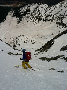 There was enough snow on the ridgeline to allow us to ski directly from the summit.  A bit of billygoating through the rocky entrance led us to the top of the line, which we dubbed the Hobbit's Way in honor of the drunken hobbit mountaineer that climbed it before us.  Me dropping in.  Photo: H.Flinch