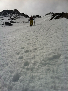 Although most of the guidebooks suggest booting up the wide couloir that leads to the saddle between Fletcher and Drift, we saw no valid reason not to boot directly up our intended line.  This allowed us to preview both snow conditions, and the state of the entrance crux, since it appeared a bit rocky to enter the line.  We found an old bootpack in the couloir from a mountaineer (no ski tracks coming down), but it weaved illogically back and forth in drunken hobbit fashion, so we elected to kick our own steps.  Me setting the boot ladder.  Photo: H.Flinch