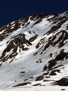 I didn't summit, instead just climbing to the top of my intended line at roughly 13,600'.  No action shots since I skied solo and didn't think to give my camera to Hans, but here's a look back up at the fun NW facing line I skied.