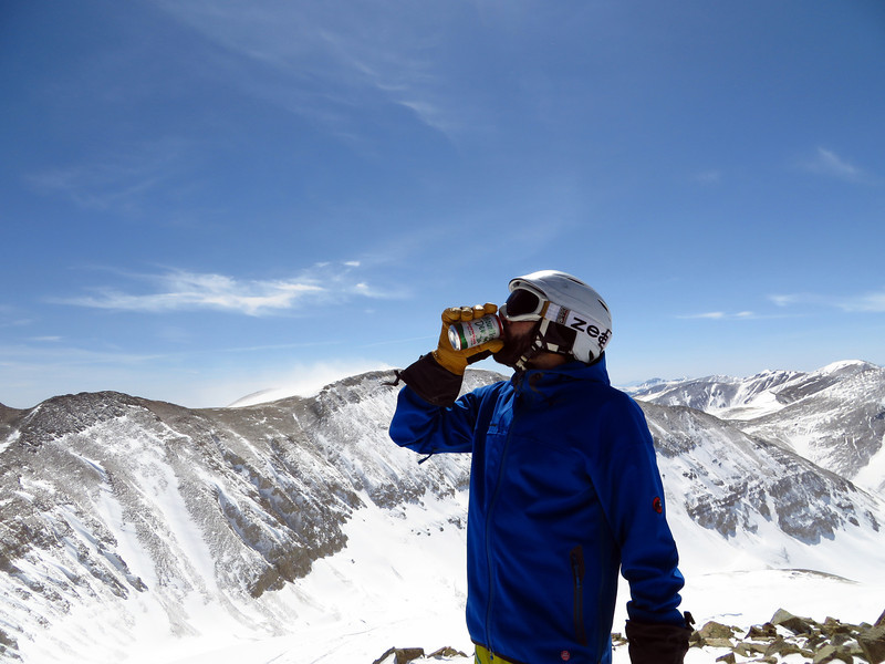 Mike has an affinity for Mountain Dew on the summit.