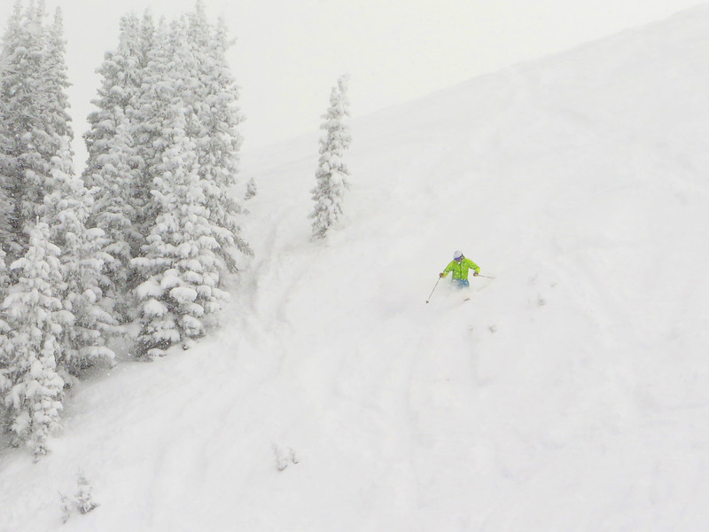 Chris slashes a turn into deep snow in Mirkwood Bowl... at 2pm.