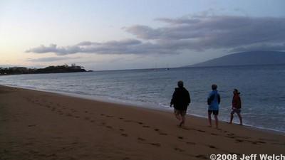 Mom, Dad, and Grandma on a morning walk on Kahekii Beach.