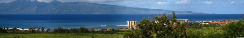A panorama of the coast where we stayed from the hill near the West Maui airport.  Our condo sits just left of the high rise hotel.  Molokai is the island visible in the background.