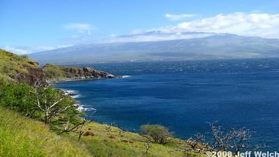 The Lahaina Pali coast and Haleakala in the background.