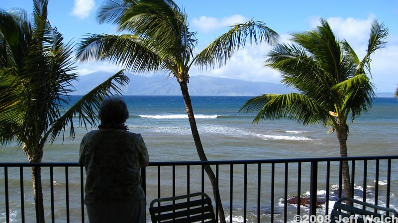 Our condo was pretty damn close to the ocean.  My grandma admires the view.<br /> We stayed in West Maui between Honokowai and Kahana.