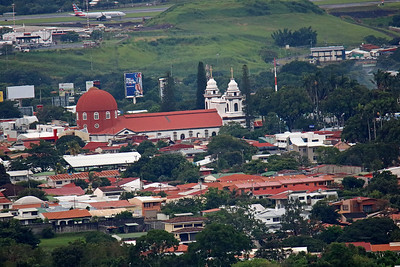 Alajuela Cathedral & Central Park - Note American Airlines Plane on Runway at Top