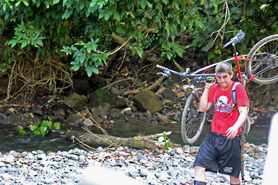 Biker Forced to Walk Over Rocks
