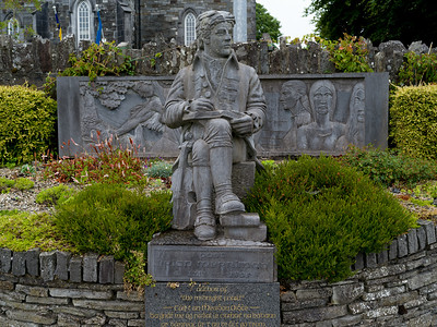 Poet Brian Merriman Statue with Teach Ceoil - St Andrew's Church, Ennistimon, Clare; Ireland