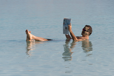 Let's read the paper in the Dead Sea!
