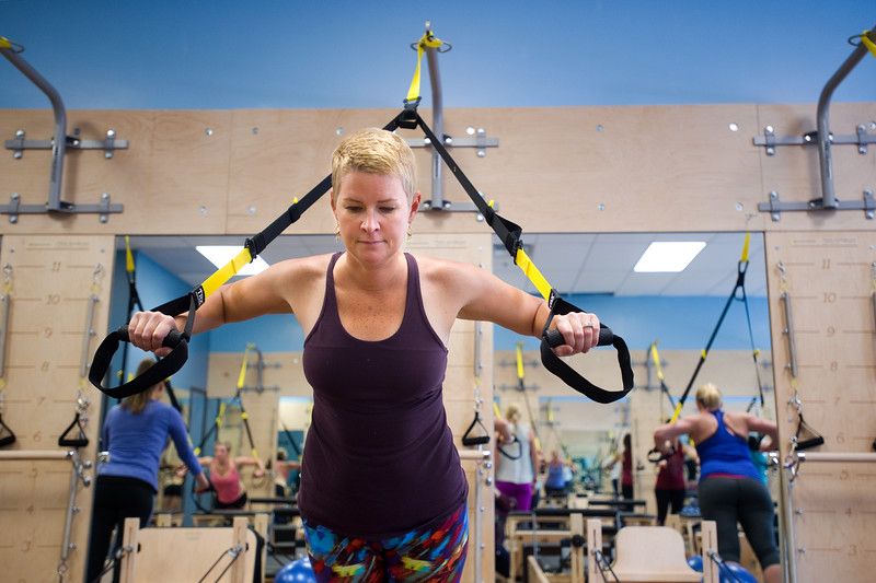 "Martha Walker uses the TRX suspension training system during the TRX/Reformer Fusion class at Club Pilates in Longmont on Wednesday. <br /> For more photos go to  <a href=""http://www.dailycamera.com"">http://www.dailycamera.com</a><br /> (Autumn Parry/Staff Photographer)<br /> May 18, 2016"