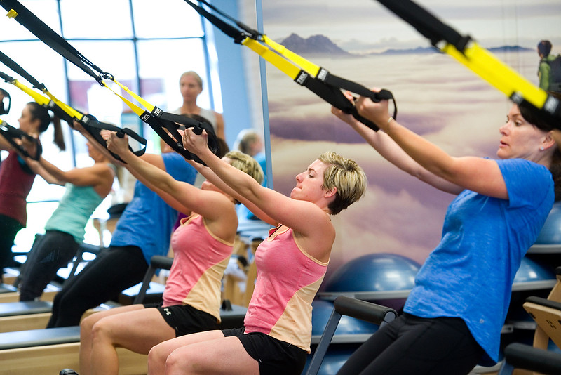 "Attendees use the TRX suspension training system during the TRX/Reformer Fusion class at Club Pilates in Longmont on Wednesday.<br /> For more photos go to  <a href=""http://www.dailycamera.com"">http://www.dailycamera.com</a><br /> (Autumn Parry/Staff Photographer)<br /> May 18, 2016"