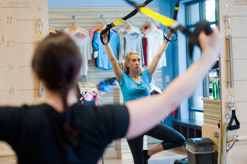 "Owner Kelly Hendricks uses the TRX suspension training system during the TRX/Reformer Fusion class at Club Pilates in Longmont on Wednesday. The class combines the benefits of TRX suspension with the pilates reformer plus workout.<br /> For more photos go to  <a href=""http://www.dailycamera.com"">http://www.dailycamera.com</a><br /> (Autumn Parry/Staff Photographer)<br /> May 18, 2016"