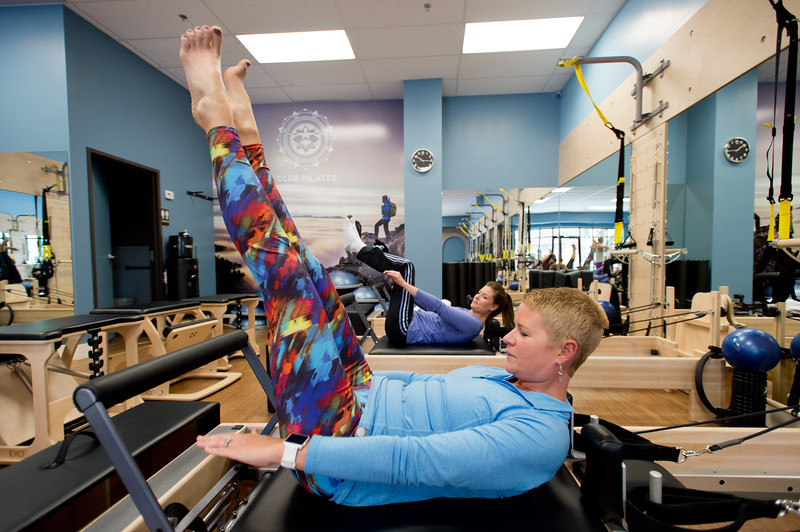 """Martha Walker uses the reformer during an exercise at the TRX/Reformer Fusion class at Club Pilates in Longmont on Wednesday. The class combines the benefits of TRX suspension with the pilates reformer plus workout.<br /> For more photos go to  <a href=""""http://www.dailycamera.com"""">http://www.dailycamera.com</a><br /> (Autumn Parry/Staff Photographer)<br /> May 18, 2016"""