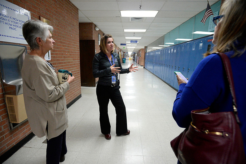 Turner Middle School Principal Brandy Grieves, center, talks with Thompson School District board members Lori Hvizda Ward, left, and Pam Howard, right, on Thursday, April 26, 2018, about some of the ways they deal with overcrowding and growth at the school in Berthoud. (Photo by Jenny Sparks/Loveland Reporter-Herald)