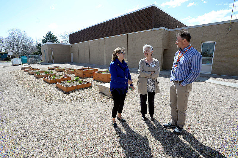 Ivy Stockwell Elementary School Principal Rick Bowles, right, shows Thompson School District board members Lori Hvizda Ward, center, and Pam Howard Thursday, April 26, 2018, where they may possibly put modular buildings outside the school in Berthoud.   (Photo by Jenny Sparks/Loveland Reporter-Herald)