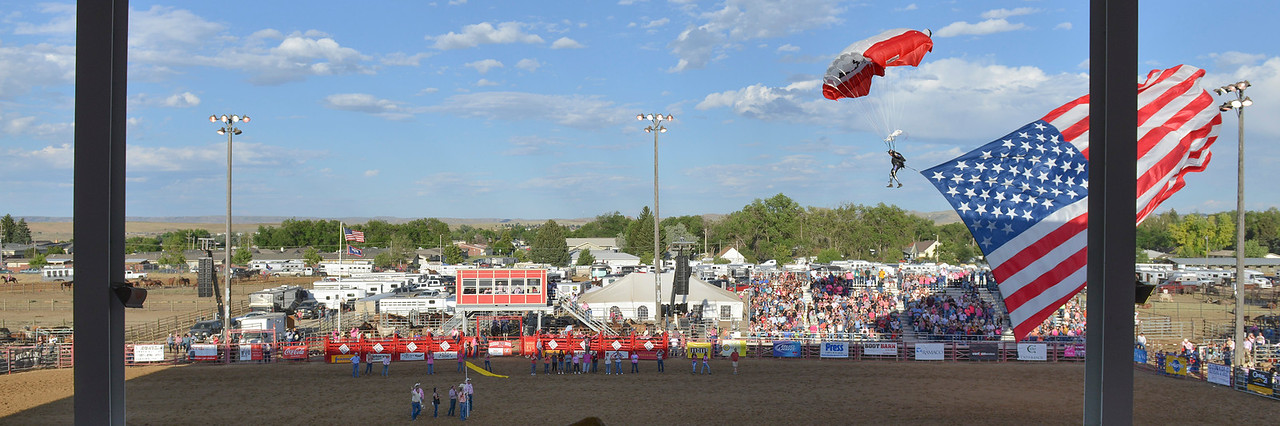 Justin Sheely | The Sheridan Press<br /> Dana Bowman enters the arena with the national flag during the second night of Sheridan WYO Rodeo Thursday at the Sheridan County Fairgrounds arena.