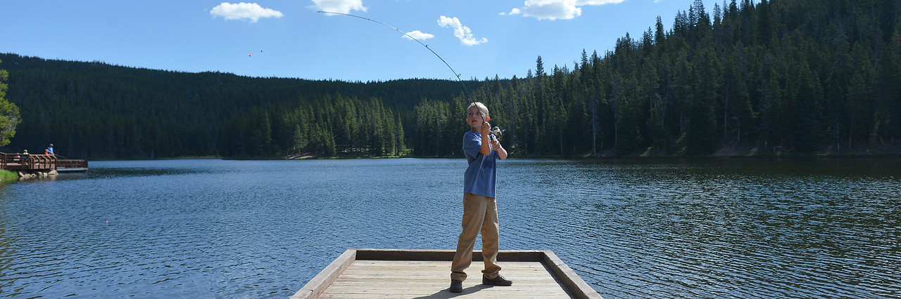 Justin Sheely | The Sheridan Press<br /> Ten-year-old Myles Walden casts a line during the Sheridan Recreation District's fishing youth program Wednesday at Sibley Lake in the Bighorn National Forest.