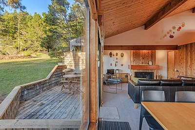 Living Room and Access to Back Deck with Meadow View