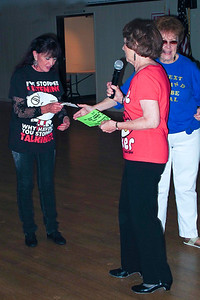 Sandra - Collecting Her Prize Photo by Bob Burns