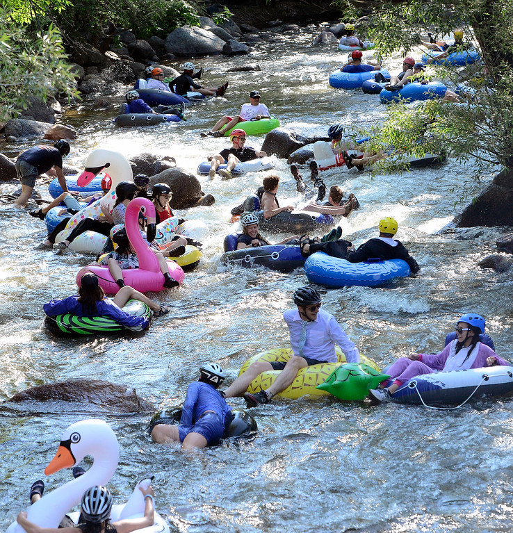 . Tubers head down Boulder Creek on Tube to Work Day 2018. Paul Aiken Staff Photographer July 11 2018