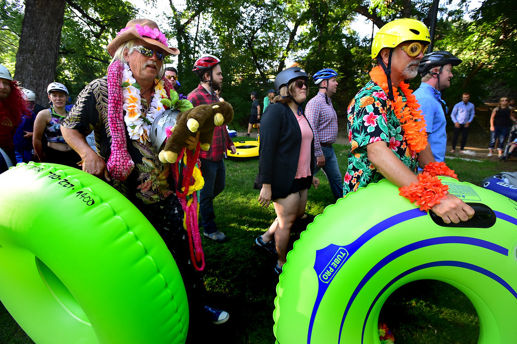. From left to right, Todd Ramquist, and John Whipple get in line to hit the water at Eben G. Fine Park for the 11th Annual Tube to Work Day on Boulder Creek on Wednesday morning.  Paul Aiken Staff Photographer July 11 2018