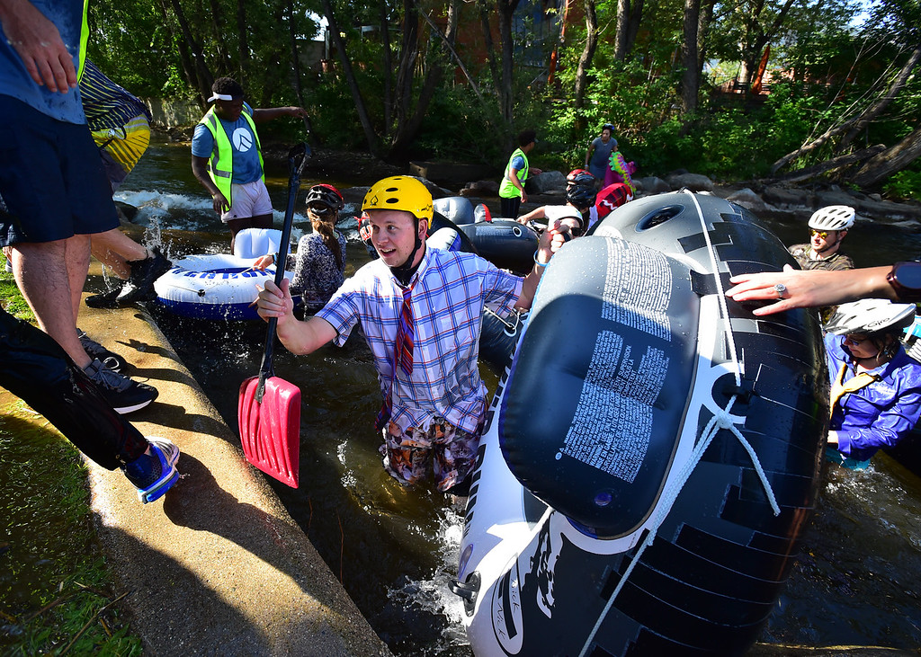 . Nick Clough gets ready to get out of Boulder Creek at the finish at Central Park during the 11th Annual Tube to Work Day on Wednesday morning.  Paul Aiken Staff Photographer July 11 2018