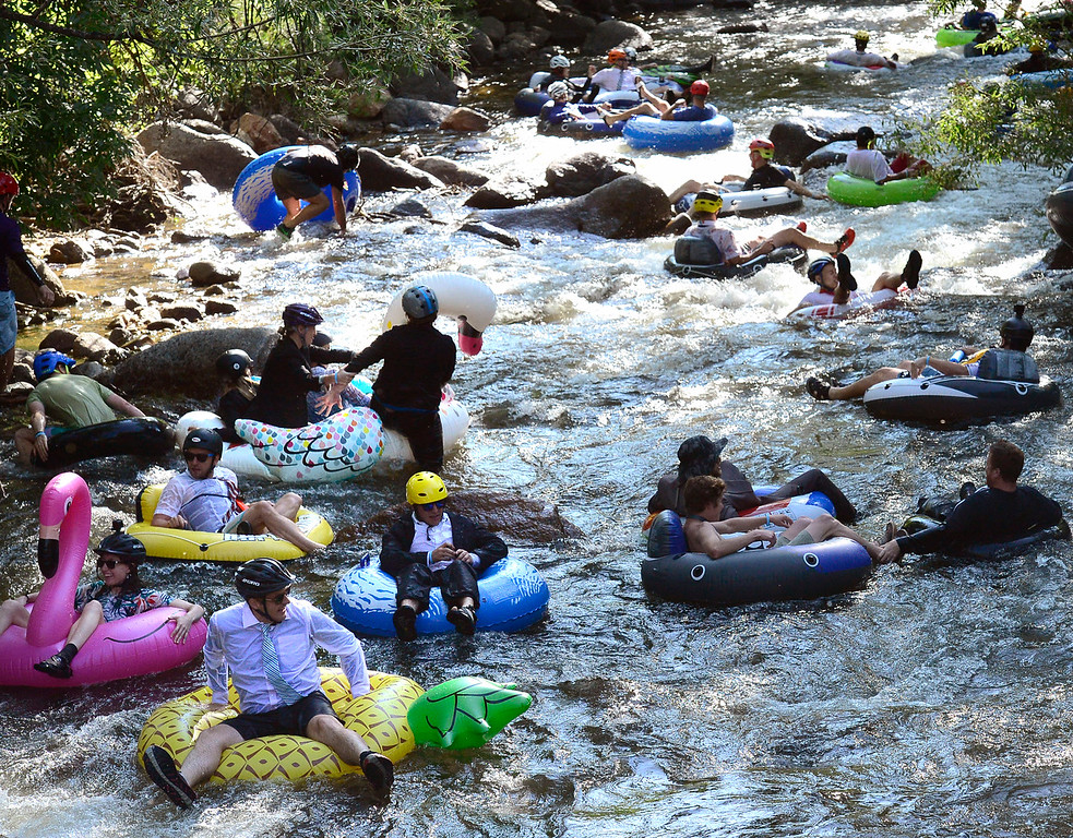 . Hordes of tubers head down from Eben G. Fine Park for the 11th Annual Tube to Work Day on Boulder Creek on Wednesday morning.  Paul Aiken Staff Photographer July 11 2018