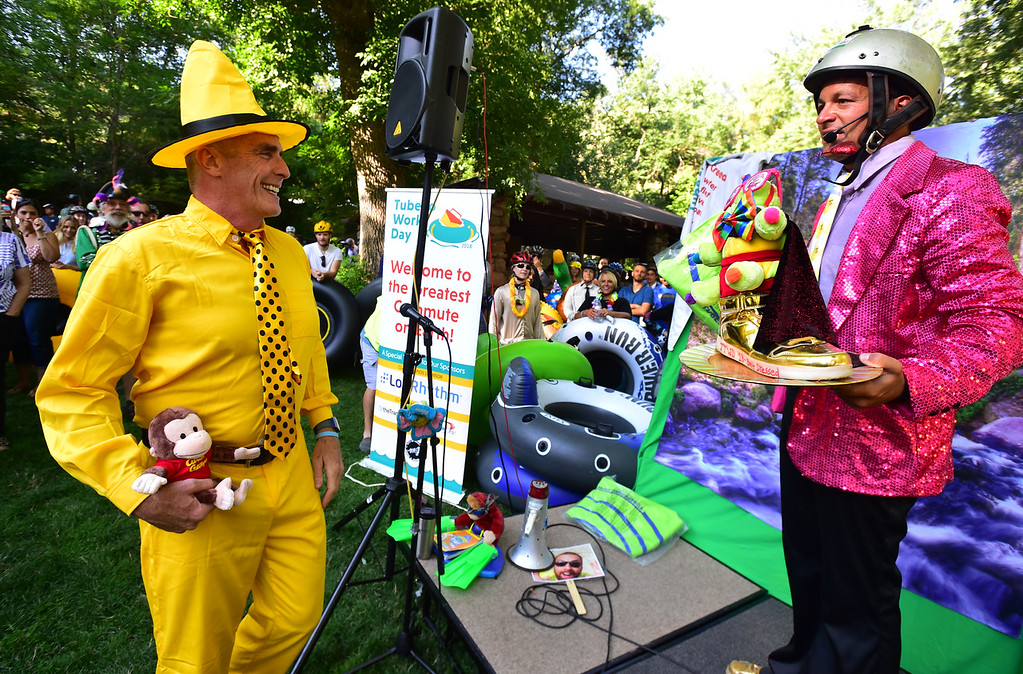 """. James Graham, \""""The Man in the Big Yellow Hat\"""" prepares to get his best costume award from Jeff Kagan, Tube to Work Day co-founder, at Eben G. Fine Park during the 11th Annual Tube to Work Day on Boulder Creek on Wednesday morning.  Paul Aiken Staff Photographer July 11 2018"""