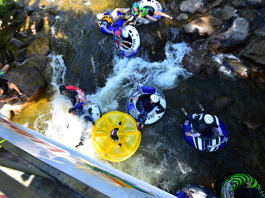 . Tubers seen from the bridge over Boulder Creek at Eben G. Fine Park during the 11th Annual Tube to Work Day on Wednesday morning.  Paul Aiken Staff Photographer July 11 2018