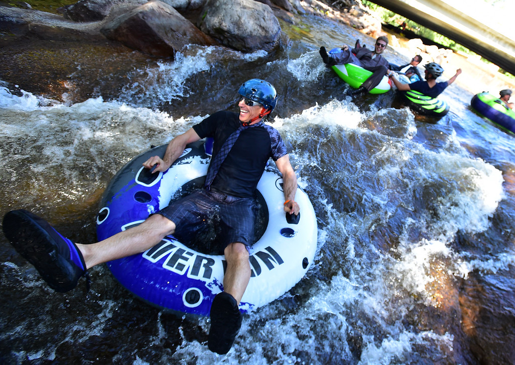 . B.C. Campbell heads Boulder Creek near the finish of the 11th Annual Tube to Work Day on Wednesday morning.  Paul Aiken Staff Photographer July 11 2018