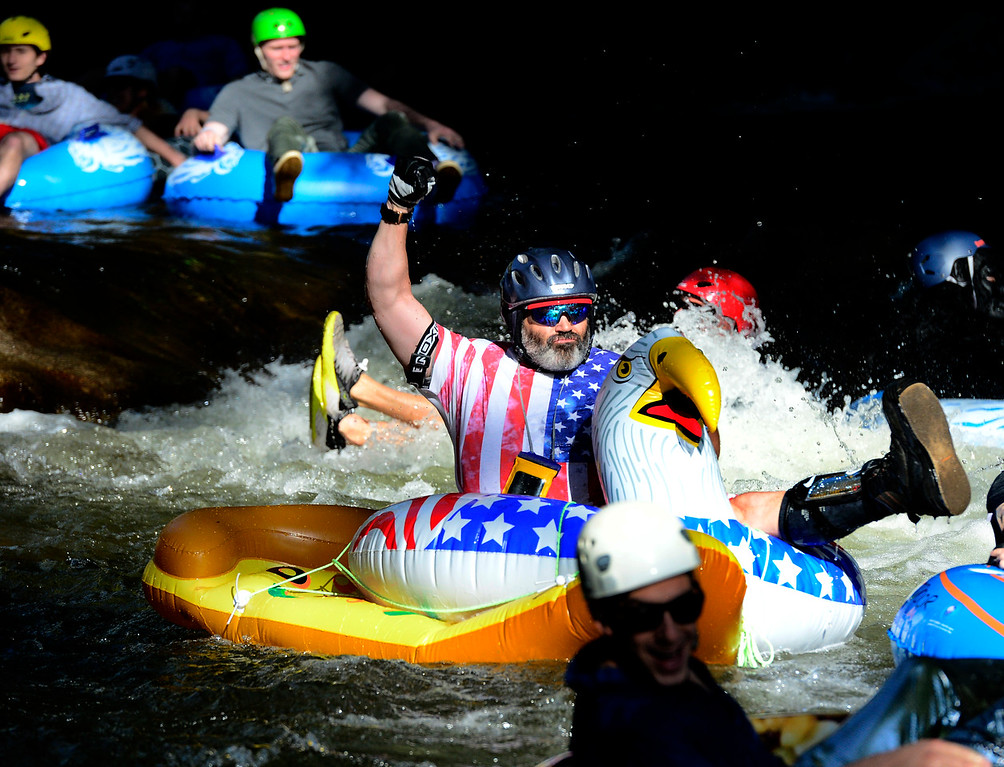 . Chris Ochs, navigates the first rapids at Eben G. Fine Park for the 11th Annual Tube to Work Day on Boulder Creek on Wednesday morning.  Paul Aiken Staff Photographer July 11 2018