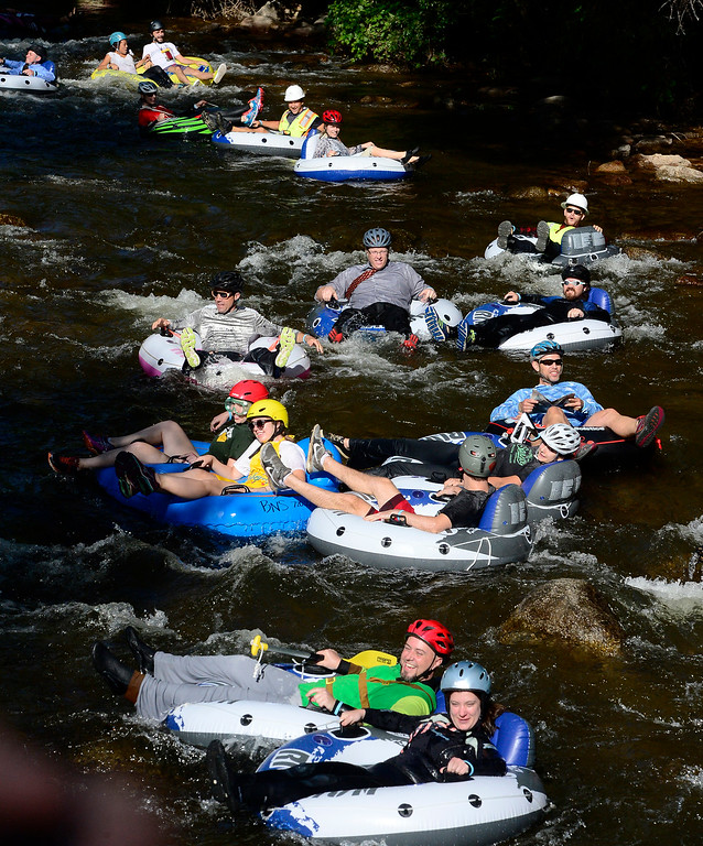 . Tubers head down from Eben G. Fine Park for the 11th Annual Tube to Work Day on Boulder Creek on Wednesday morning.  Paul Aiken Staff Photographer July 11 2018