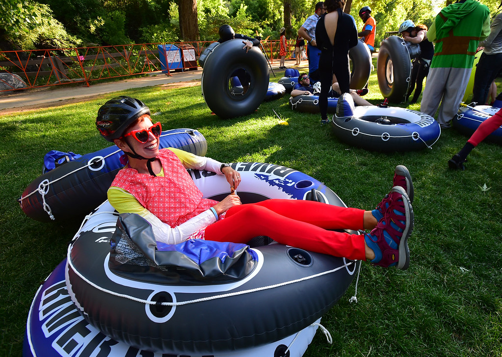 . Jenn Baefre, who traveled all the way from Florida to participate in the 11th Annual Tube to Work Day, waits for the start of the event in Eben G. Fine Park in Boulder on Wednesday morning.  Paul Aiken Staff Photographer July 11 2018