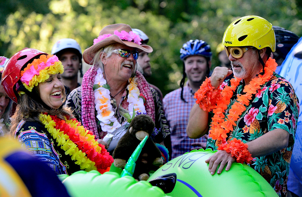 . From left to right, Lynn Whipple, Todd Ramquist, and John Whipple get themselves ready at Eben G. Fine Park for the 11th Annual Tube to Work Day on Boulder Creek on Wednesday morning.  Paul Aiken Staff Photographer July 11 2018