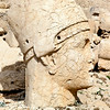Mount Nemrout - West Terrace : Head of Apollo-Mithras.The tomb (Hierotheseion) of Antiochos is one of the most ambitious constructions of the Hellenistic period. Its complex design and colossal scale combined to create a project unequalled in the ancient world
