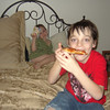 Evrett eating Pizza the first night they arrived. They were so excited!!