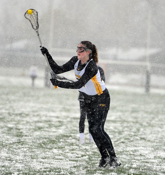 Annalise Carr attacks the net after a stoppage against St. Mary's Academy on Monday, April 29 at Patterson Stadium. Thompson Valley won 8-3. (Colin Barnard/Loveland Reporter-Herald)
