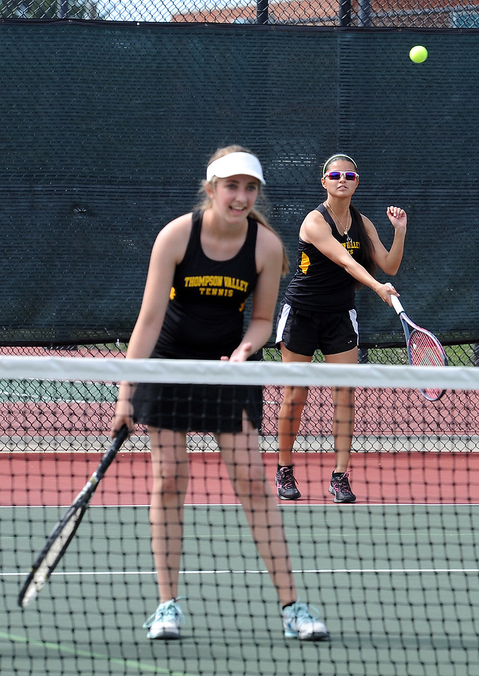 Thompson Valley's #3 doubles Lauren Davies, left, and Jenna Castaneda, play their match against Mountain View's Justine Meese and Mallory Gray Thursday, May 6, 2016, during 4A regional tennis at Centennial Park in Greeley. (Photo by Jenny Sparks/Loveland Reporter-Herald)