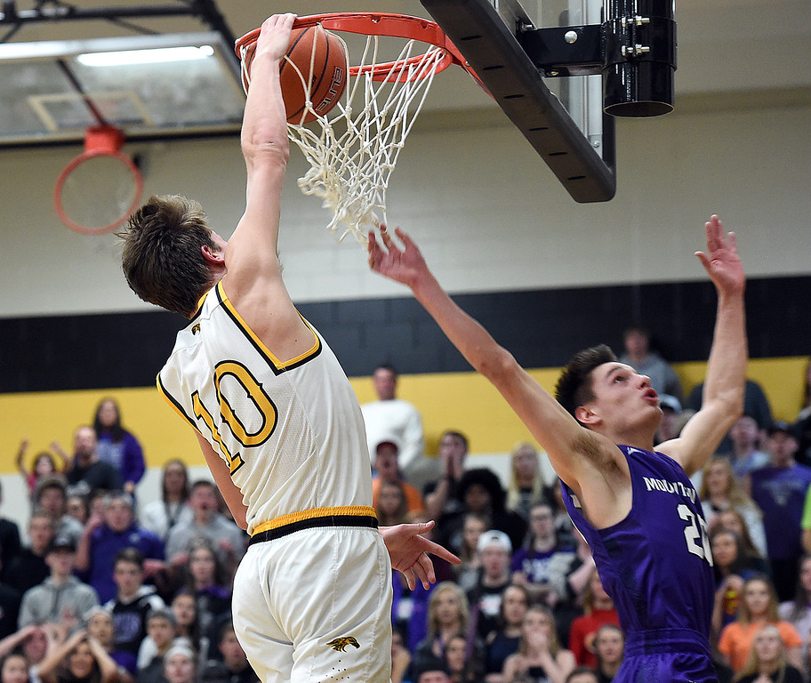 Thompson Valley's #10 Justin Wiersema dunks during their game against Mountain View Friday, Jan. 27, 2017, at Thompson Valley High School in Loveland.   (Photo by Jenny Sparks/Loveland Reporter-Herald)