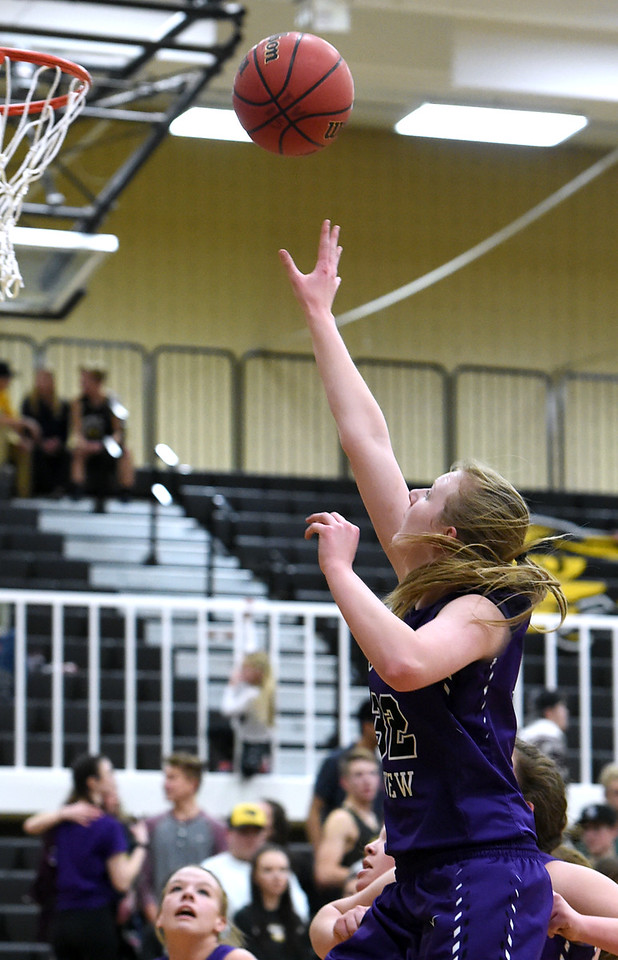 Mountain View's #32 Brynne Rydbom goes up for a shot during their game against Thompson Valley Friday, Jan. 27, 2017, at Thompson Valley High School in Loveland.   (Photo by Jenny Sparks/Loveland Reporter-Herald)