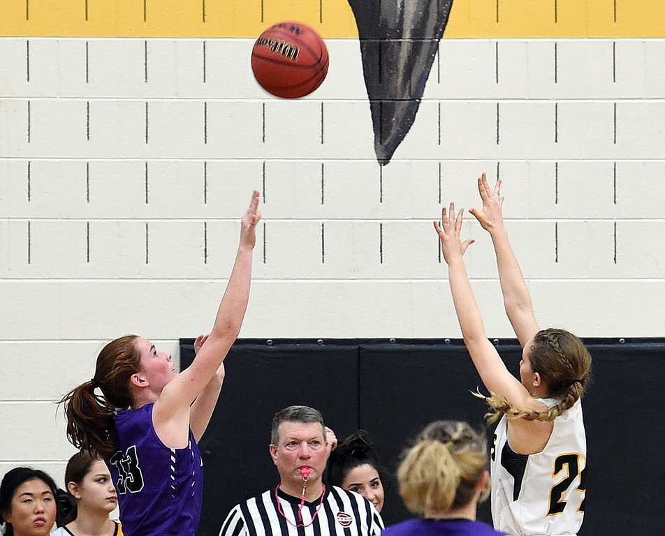 Mountain View's #33 Gabby Valland goes up for a shot as Thompson Valley's #24 Lacy Sauer tries to block during their game Friday, Jan. 27, 2017, at Thompson Valley High School in Loveland.   (Photo by Jenny Sparks/Loveland Reporter-Herald)